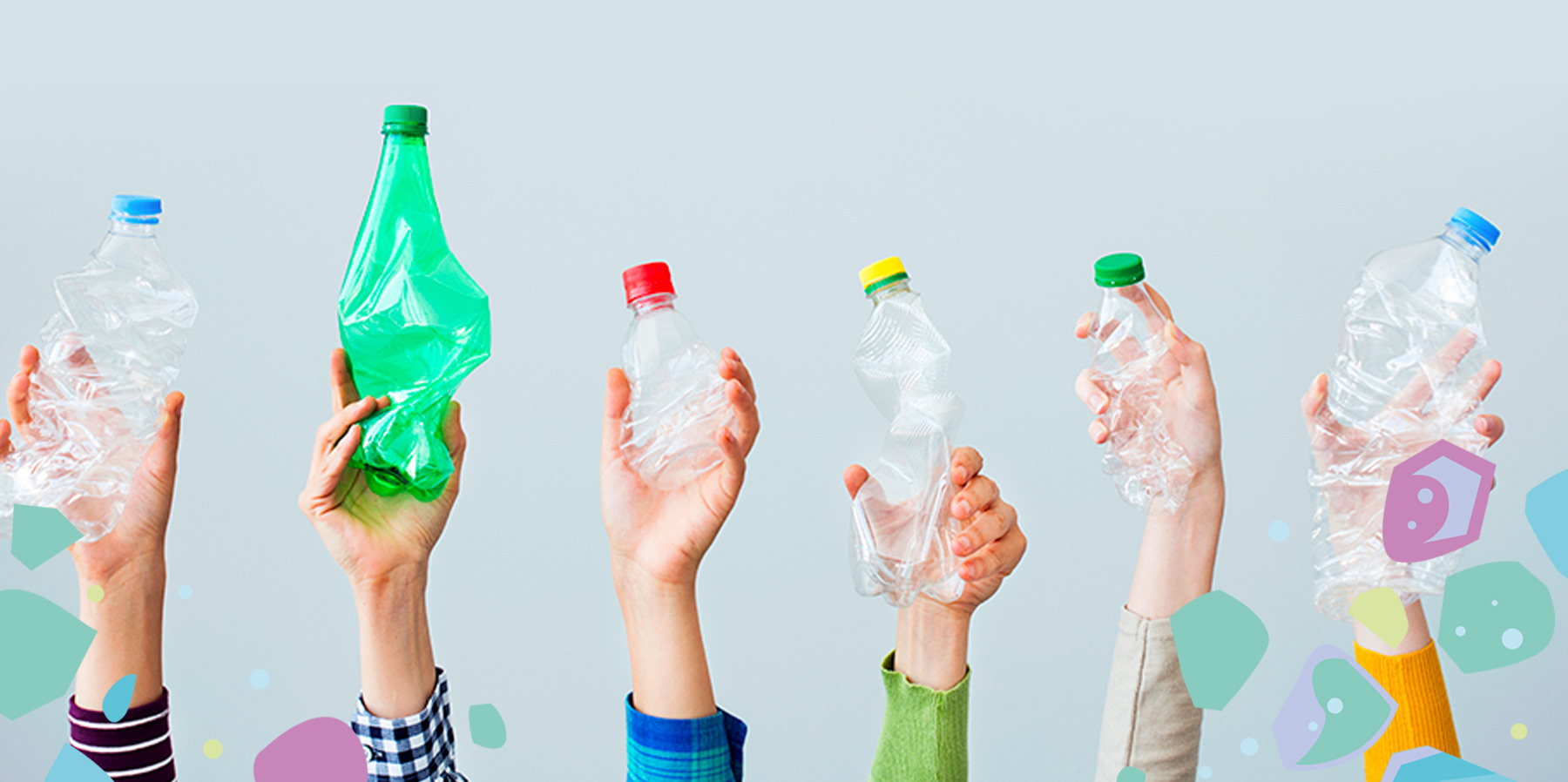 Six hands holding up empty plastic bottles, showing the importance of going plastic-free with Bonnie Bio UK