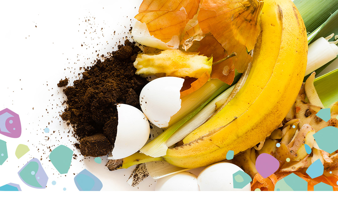 A pile of soil, egg shells, onion skins, a banana peel, apple core, and vegetable matter showing items that are compostable