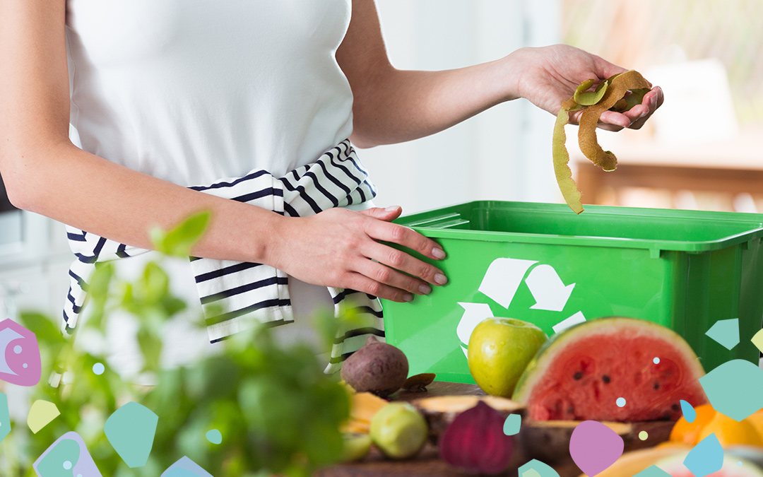 A woman throwing peels into a green compost box for kitchen food waste