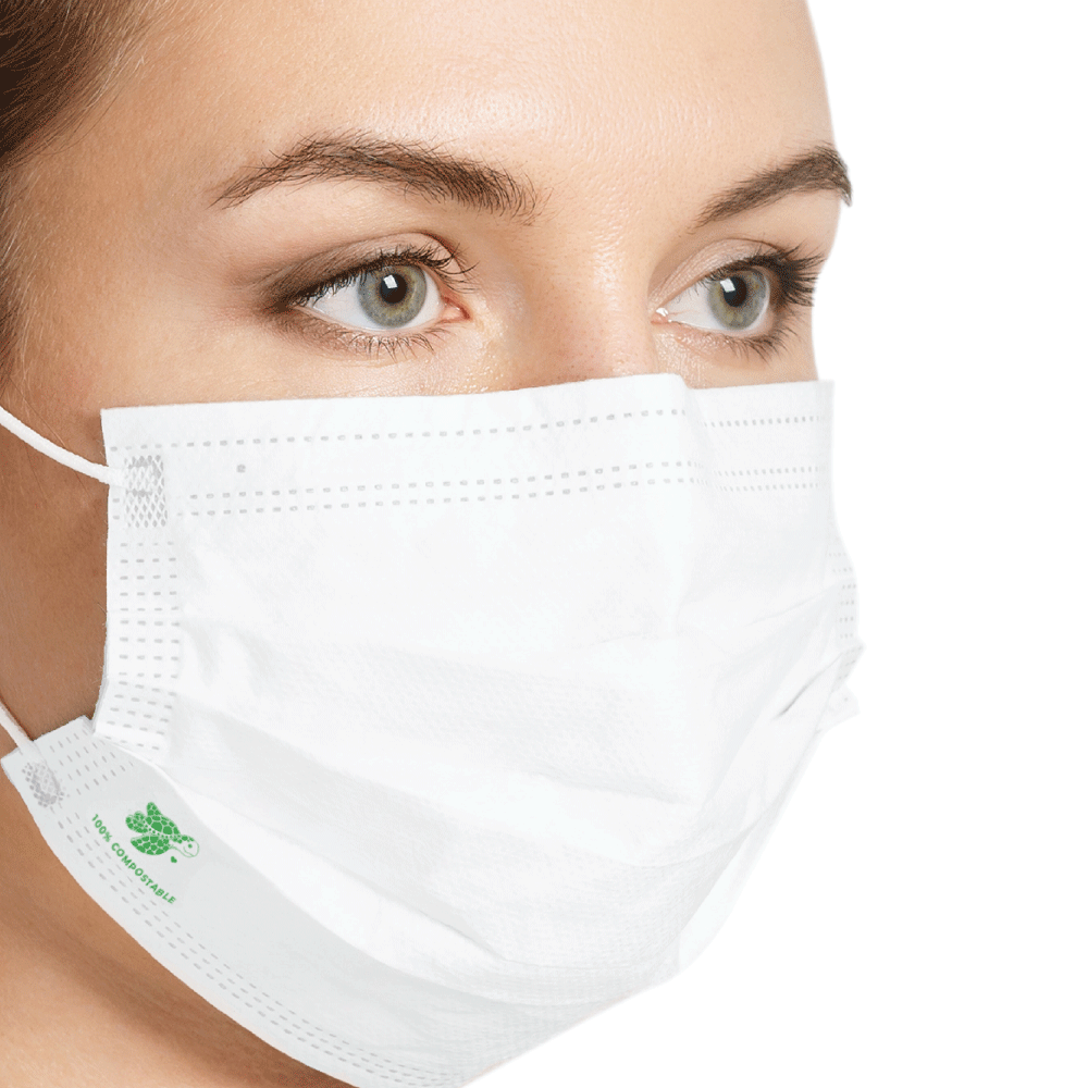A woman wearing a compostable face mask in a surgical face mask design from Bonnie Bio UK
